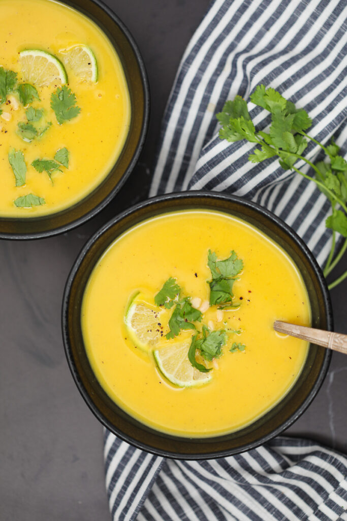 butternut squash soup vegan recipe in black bowls