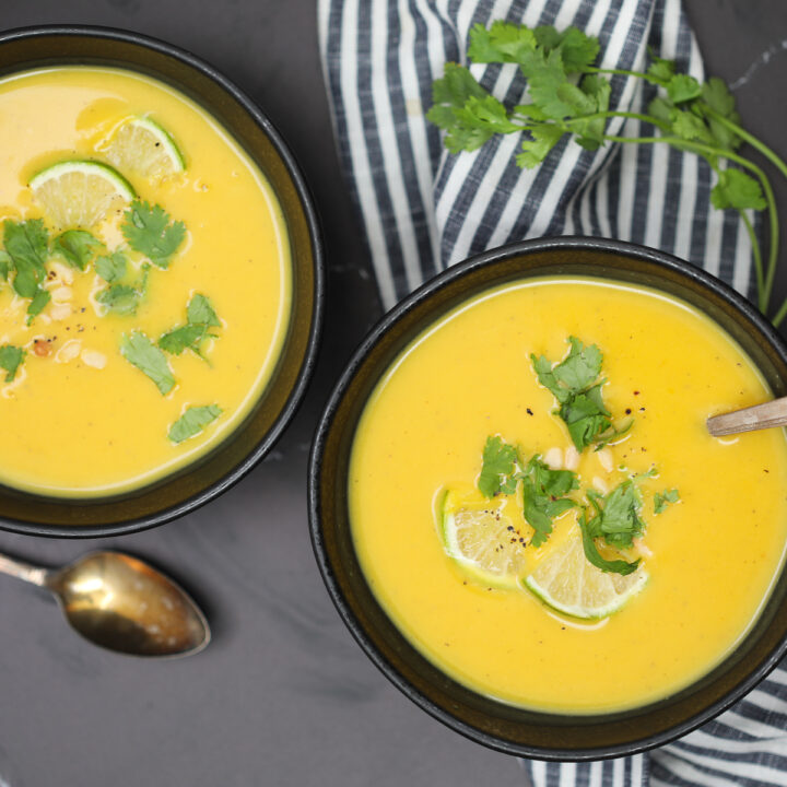 recipe for vegan butternut squash soup ready to eat in black bowls
